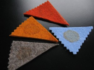 Felt samples with heavy tea stains