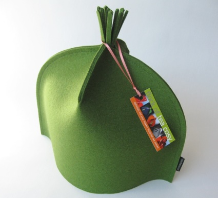 Elegant modern tea cozy topped by a tassel in fresh Moss Green wool felt