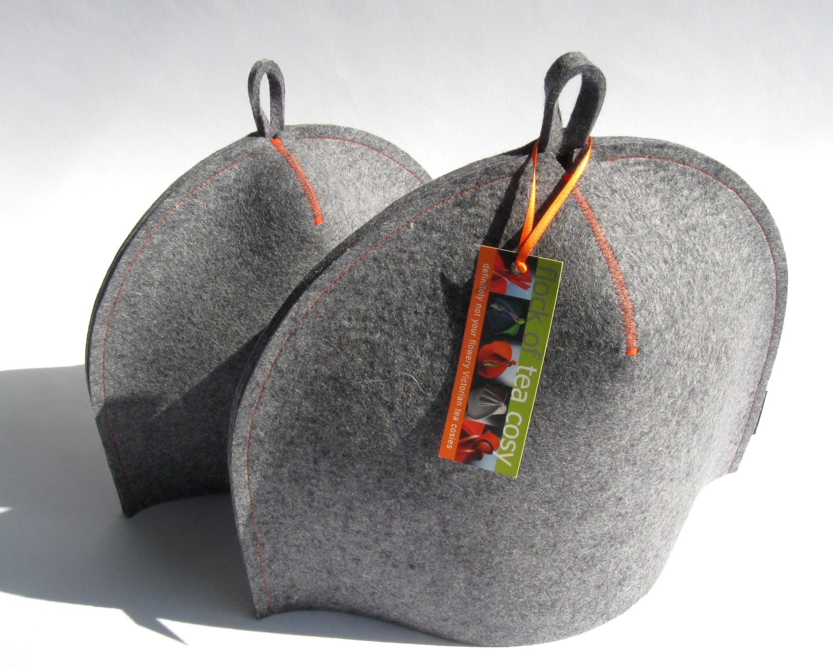 "A pair of Classic ""Baseball"" tea cozies in industrial wool felt by Flock of Tea Cosy"