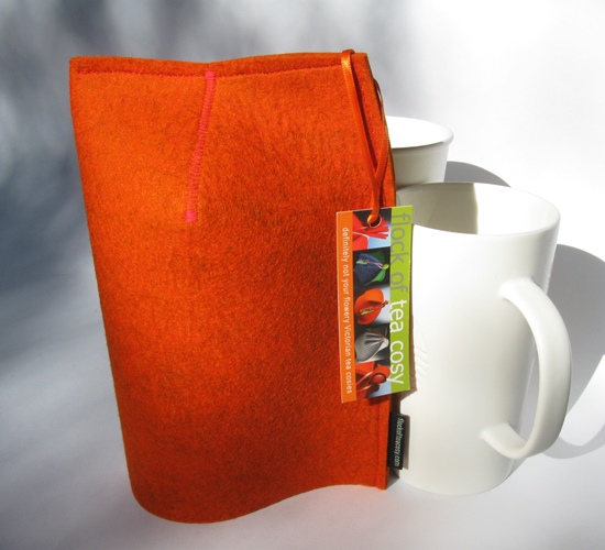 Sleek modern mug cosy in thick Burnt Orange wool felt for 16oz mug