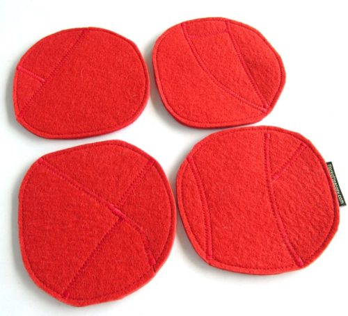 Four coasters in organic shapes