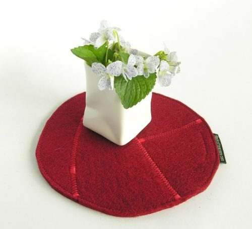 Eco conscious hotpad made from recycled wool felt offcuts in Mulberry Red
